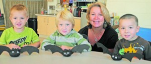 Early Intervention Teacher Deb Quilter Helps Students Make Bat Pumpkins