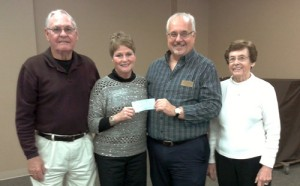 AARP President Presents Check To Friends Of WCDC