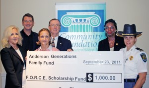 Community Foundation Of The ES Recieve Check For $1,000