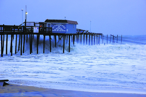 Iconic pier s history rooted in damage rebuilding for Surf city pier fishing report