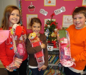 Third Graders At OC Elementary Fill Stockings For The Salvation Army