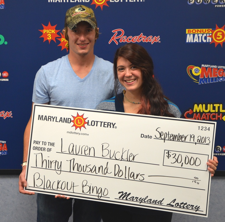 Lottery winner Lauren Buckler is pictured with her, Michael Marciano, receiving her winnings. Photo by Md. Lottery