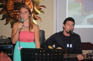 "Hannah Saulsbury and Jamie McDonald performed Phillip Phillips' song ""Home"" for the audience."