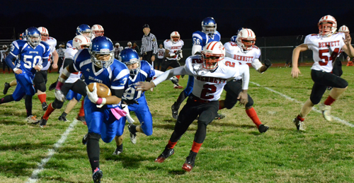 Decatur running back P.J. Copes busts loose for a big gain against Bennett last Friday. Copes finished with three touchdowns in the Seahawks' 49-0 win.  Photo by Bob Hammond
