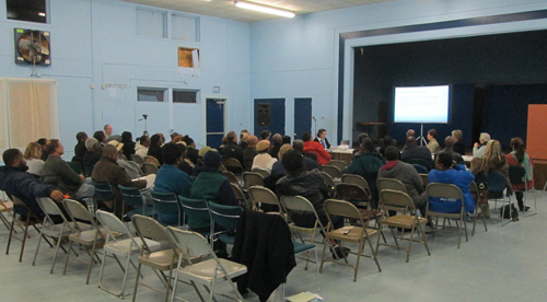 Concerned citizens are pictured at the Flower Street Community Center on Tuesday evening discussing safety improvements for Route 113. Photo by Travis Brown