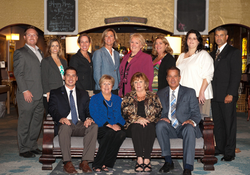 Pictured, from left, at the recent Coastal Association of Realtors' Annual Meeting and Installation are, seated from left, Joel Maher, Linda, Moran, Pam Wadler and Don Bailey; and standing, Wesley Cox, Joni Williamson, Brigit Taylor, Lauren Bunting, Susan Megargee, Vicki Harmon, Courtney Wright and Darron Whitehead.