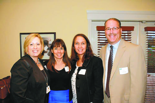 Pictured, from left, are Cedar Chapel Special School Principal Belinda Gulyas, Ocean City Elementary School Principal Dawn Rogers, OCES first grade teacher Windy Phillips, and Worcester County Public Schools' Chief Operating Officer Louis Taylor. Submitted Photo