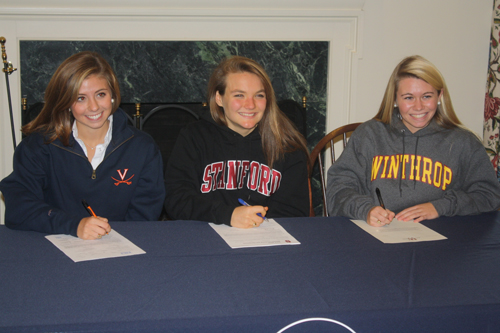Three Worcester Prep standout girls' varsity lacrosse players last week formalized their commitment to continue their careers at the next level at high profile universities by signing letters of intent. Pictured above, from left: Lilly DiNardo, who is headed to Virginia; Maddie Pilchard, who will play next year at Stanford; and Kristen Shriver, who accepted a scholarship offer from Winthrop University.  Photo by Shawn Soper