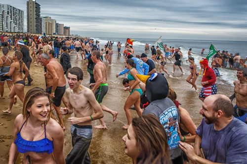 Some of the hundreds of participants are pictured in last year's Atlantic General Hospital Penguin Swim.  Photo by Chris Parypa