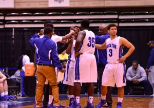 Stephen Decatur's boys varsity basketball team, pictured above during a timeout at last week's Governor's Challenge Holiday Tournament in Salisbury, split its two games in the tourney, falling to Dunbar in its first game, but rallying to beat Dickinson in its second game.  Photo by Earl Campbell