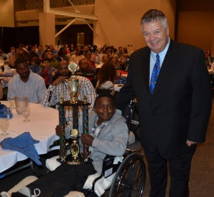 "BIS student and Pop Warner standout Cameron Smith, who was seriously injured in a collision with a county school bus in Berlin in October last week was recognized with an honorary ""Tough Guy"" award from Atlantic Physical Therapy President and CEO Bob Hammond. Hammond has been recognizing the ""Tough Guy of the Week"" award for the Stephen Decatur High School football team for a decade. Pictured above, Hammond presents the trophy to Smith.  Submitted photo"