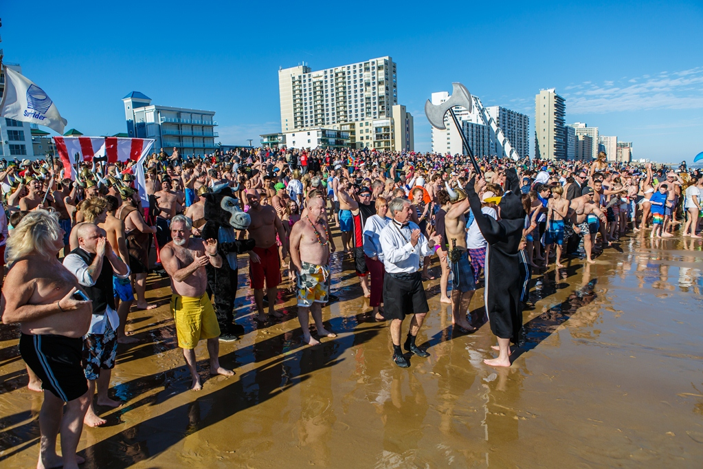 About 750 people took a freezing plunge into the Atlantic Ocean on New Year's Day for the 20th Annual Penguin Swim. Photos by Chris Parypa