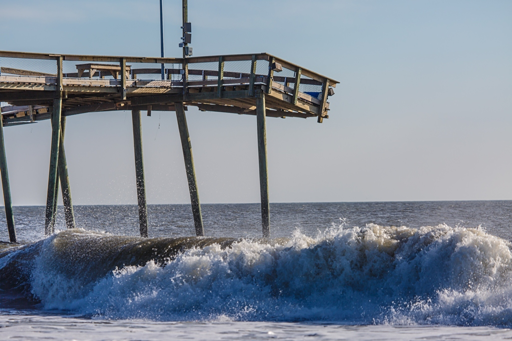 Early Friday morning, the Wicomico Street Pier's damaged pilings were being cut into smaller pieces and removed from the beach. Photo by Chris Parypa