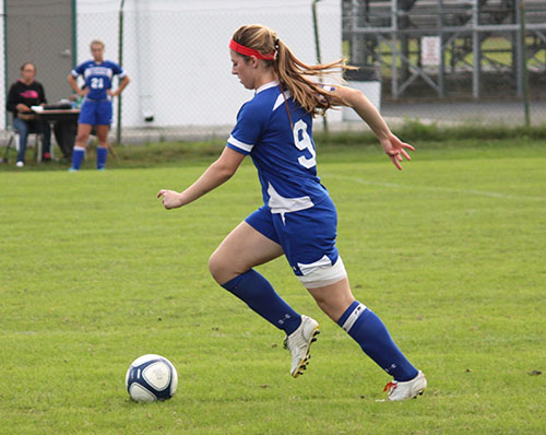 Decatur soccer standout Rebecca Lederman, pictured here in action from the fall season, last week signed a letter of intent for an athletic and academic scholarship for Division I Canisius College in upstate New York.  Submitted photo