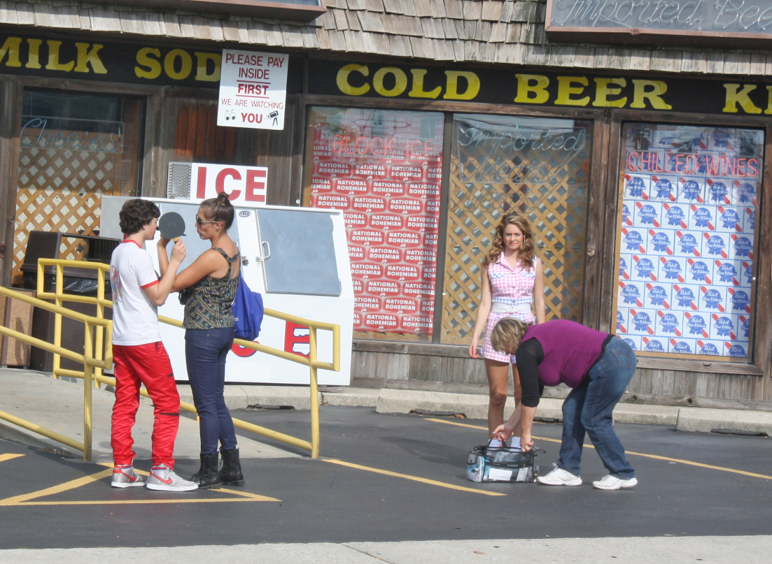 Actors Marcello Conte and Emmi Shockley (a local resident) are pictured during filming in front of Anthony's Beer and Wine in late 2012. Photo by Shawn Soper