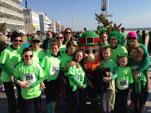 The St. Patrick's Boardwalk 5K last Saturday was a huge success with nearly 1,000 runners competing. Pictured above, the happy crew from Yogavibez celebrates near the finish line with a leprechaun.  Photo by Dawn Marohl