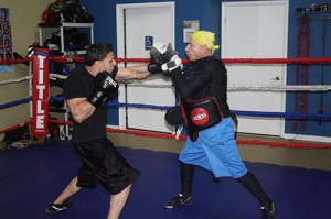 "O.C. Fight Club owner and trainer Charlie Rites (right) spars with UFC fighter Rubin Martinez last Friday at the club's new facility on Route 50 during a seminar and training session provided by UFC professional fighter Charlie ""The Spaniard"" Brenneman.   Photo by Shawn Soper"