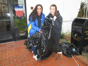 Students Zainab Mirza and Maury Izzett are pictured during last week's cleanup project outside City Hall in Ocean City. Photo by Travis Brown