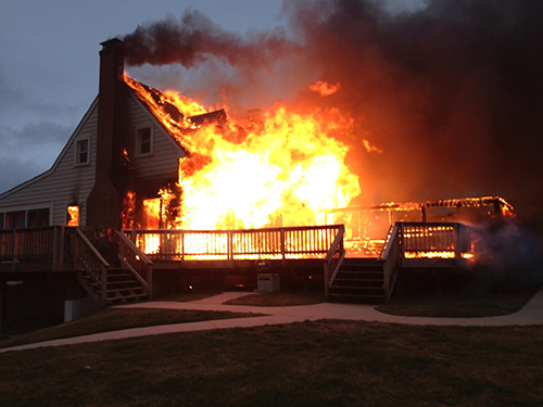 A residence on Burbage Road off Assateague Road near Berlin caught on fire Monday morning just prior to the snow arriving. Above was a photo taken shortly after first responders arrived on the scene. Photo by Moe Cropper