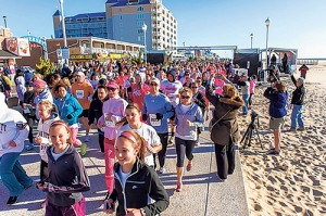 Participants in the 5K are pictured at the starting line last year on the Boardwalk. Photo by Chris Parypa