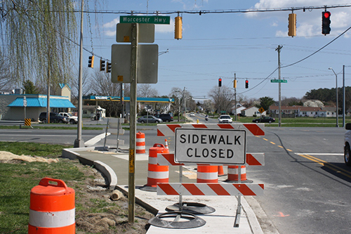 Sidewalk work is taking place this week at the intersection of Bay Street and Route 113. Photo by Shawn Soper