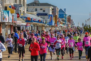 Participants eye the finish line amid supporters during last year's Komen Maryland Ocean City Race for the Cure. Photo by Chris Parypa