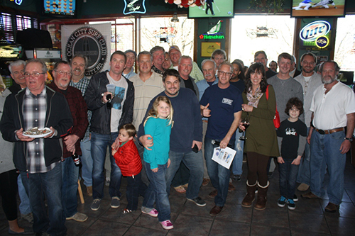 Some of the new members who joined the Ocean City Surf Club last weekend are pictured with club organizers and supporters at the Greene Turtle West. Photo by Shawn Soper