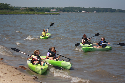 The Maryland Coastal Bays Program and SuperFun Eco Tours last week were awarded the contract to provide concessions at Assateague Island National Seashore including food and beverage service, kayak, canoe and bike rentals and other services. Pictured above is a scene from last summer of kids enjoying kayaks at the barrier island.  Photo by Shawn Soper