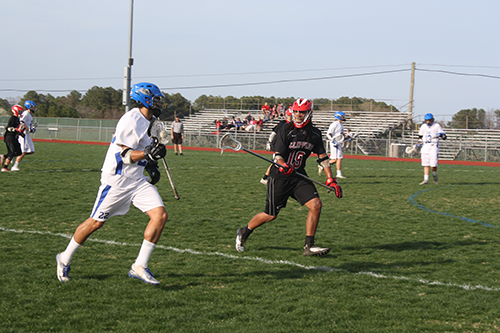 Decatur's Matt LeCompte works the ball in against the Bennett defense during the Seahawks' 19-5 win on Monday. LeCompte went on run with two goals and an assist during a three-minute stretch in the second quarter.  Photo by Shawn Soper
