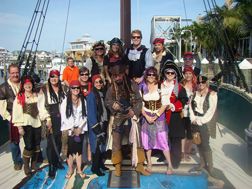 Volunteers serving as pirates and raising money for the local CASA program are pictured at Sunset Grille during last year's event. File Photo