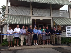 Officials are pictured on Tuesday cutting the ceremonial ribbon on the 150th façade improvement project on 11th Street in Ocean City. Photo by Joanne Shriner