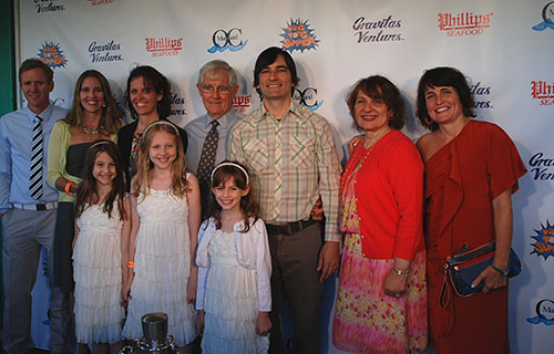 """Ping Pong Summer"" writer and director Michael Tully, center, is pictured with his family at last Friday's local premiere of the movie at the Fox Sun N Surf 8 Cinema. Photo by Jeanette Deskiewicz"
