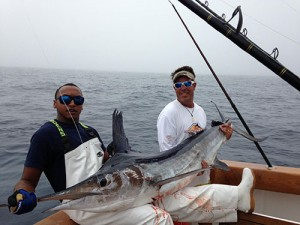 "Mate Donnie Culber and angler John Henry aboard the ""No Worries"" are pictured with the first white marlin caught this year off Ocean City. Submitted Photo"