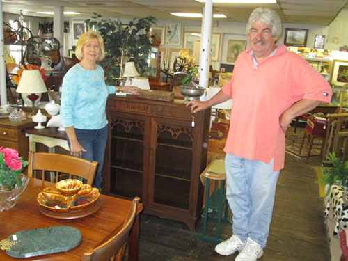 Route 346 Emporium owners Faye and Joe Holloway stand inside their Parsonsburg business. Photo by Travis Brown