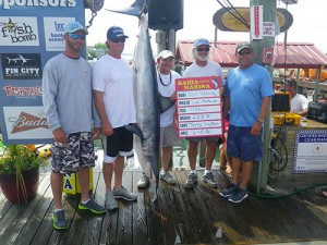 "Angler Tim McGuire and the happy crew on the local boat ""Nontypical"" weighed this nice 223-plus-pound mako last Sunday to take first place in the annual Mako Mania Tournament at Bahia Marina. The winning mako earned the ""Nontypical"" crew $38,030 in prize money.   Photo by Adam Hoerner"