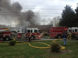 The Berlin Fire Company is pictured on the scene of an active residential fire in the spring. File Photo