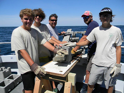 "While aboard the ""Morning Star,"" a group of local Boy Scouts from Troop 225 last week made another significant contribution of concrete artificial reef units to the growing Eagle Scout Reef about seven miles off the coast.  Submitted photo"