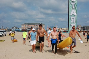 Last year's Swim Ocean City participants are pictured entering the water along with their kayak supporters. Submitted Photos