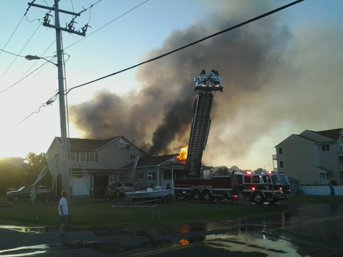 The June 26 fire ravaged the West Ocean City home located at the corner of Golf Course and Old Bridge roads. Photo by Shawn Soper