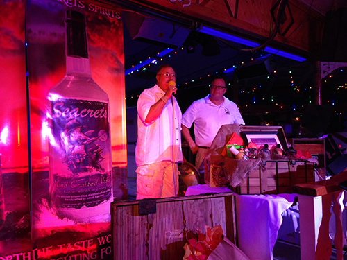 Seacrets owner Leighton Moore and Vice President Gary Figgs address the attendees at last weekend's official launch of several new products under the Seacrets brand. Photos by Joanne Shriner