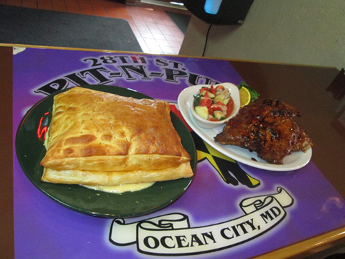 Among the favorite dishes at the 28th Street Pit-N-Pub are the chicken pot pie, left, and barbeque ribs. Photos by Travis Brown