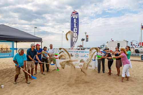 OC Sandfest kicked off its two-week run of activities on Monday with a ceremonial toss of the sand by promoters, organizers and sponsors. Photo by Chris Parypa