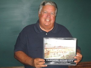 "Author Hunter ""Bunk"" Mann is pictured with his 220-page book that provides a rich documentation of Ocean City's history. Photo by Travis Brown"
