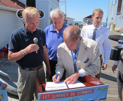 "Along with Comptroller Peter Franchot, left, signing the petition to start schools after Labor Day in Maryland were State Senator Jim Mathias, hotelier and amusement park owner Charles ""Buddy"" Jenkins and the Harrison Group's G. Hale Harrison. Photo by Shawn Soper"