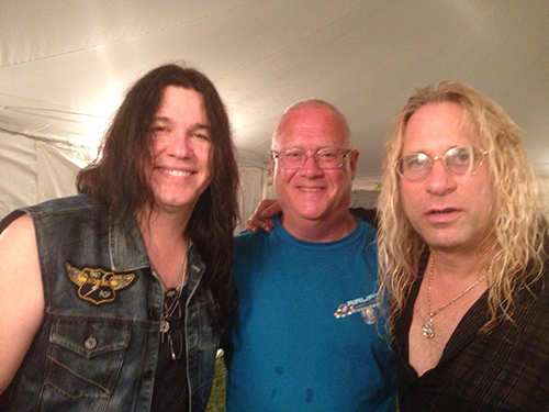 Soundwave Music Festival promoter Tim Keane, center, is pictured at last year's event with Slaughter band members Mark Slaughter and Dana Strum. Not pictured is co-promoter Mark Odachowski. File Photo