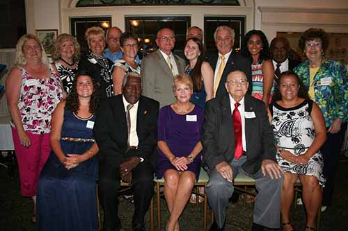 "The Worcester County Commissioners and Volunteer Services Manager Kelly Brinkley recognized 12 individuals during the annual Volunteer Spirit of Worcester County Awards dinner ceremony at the Atlantic Hotel in Berlin. Front row, from left, are Hannah Black, Tommy Mason, Cathy Gallagher, Clayton ""Claytie"" Collins, Jr., and Diane Hurney; and, second row from left, Patty Brasure, Sharon Sorrentino, Nancy Engelke, Cindi Strawley, Commissioner Merrill Lockfaw, Emily Scheiber, Commissioner Bud Church, Zainab Mirza and Commissioners Jim Purnell and Judy Boggs; and, back, Ron Michaels and Commissioner Jim Bunting."