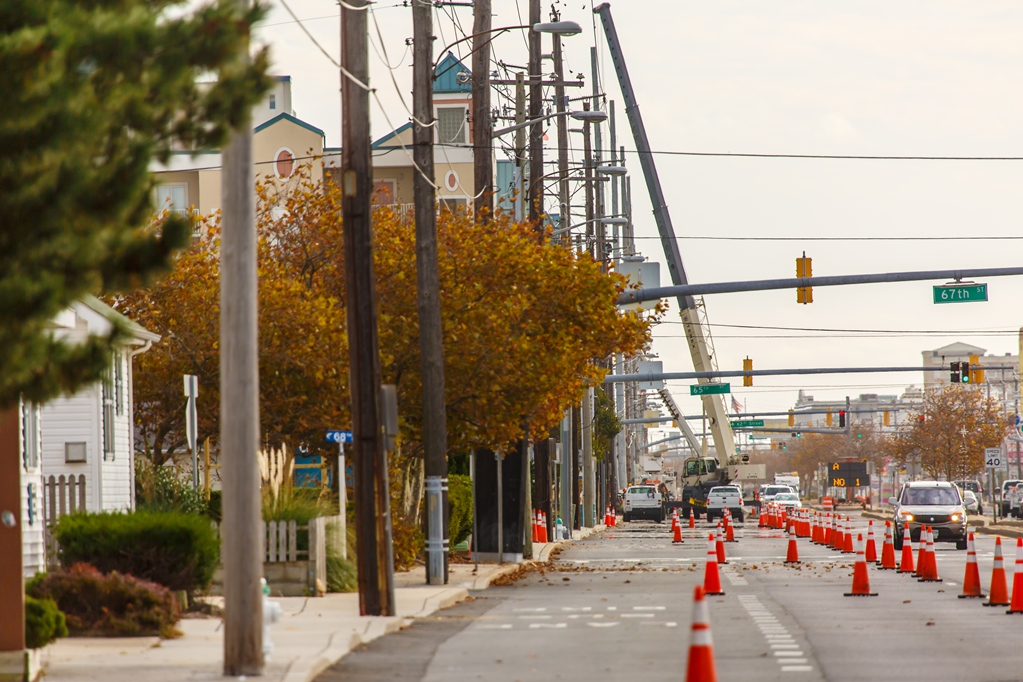 Utility poles are pictured being replaced last fall in Ocean City. Like the planned project along Route 50, wooden poles were replaced with taller steel poles along Coastal Highway. Photo by Chris Parypa