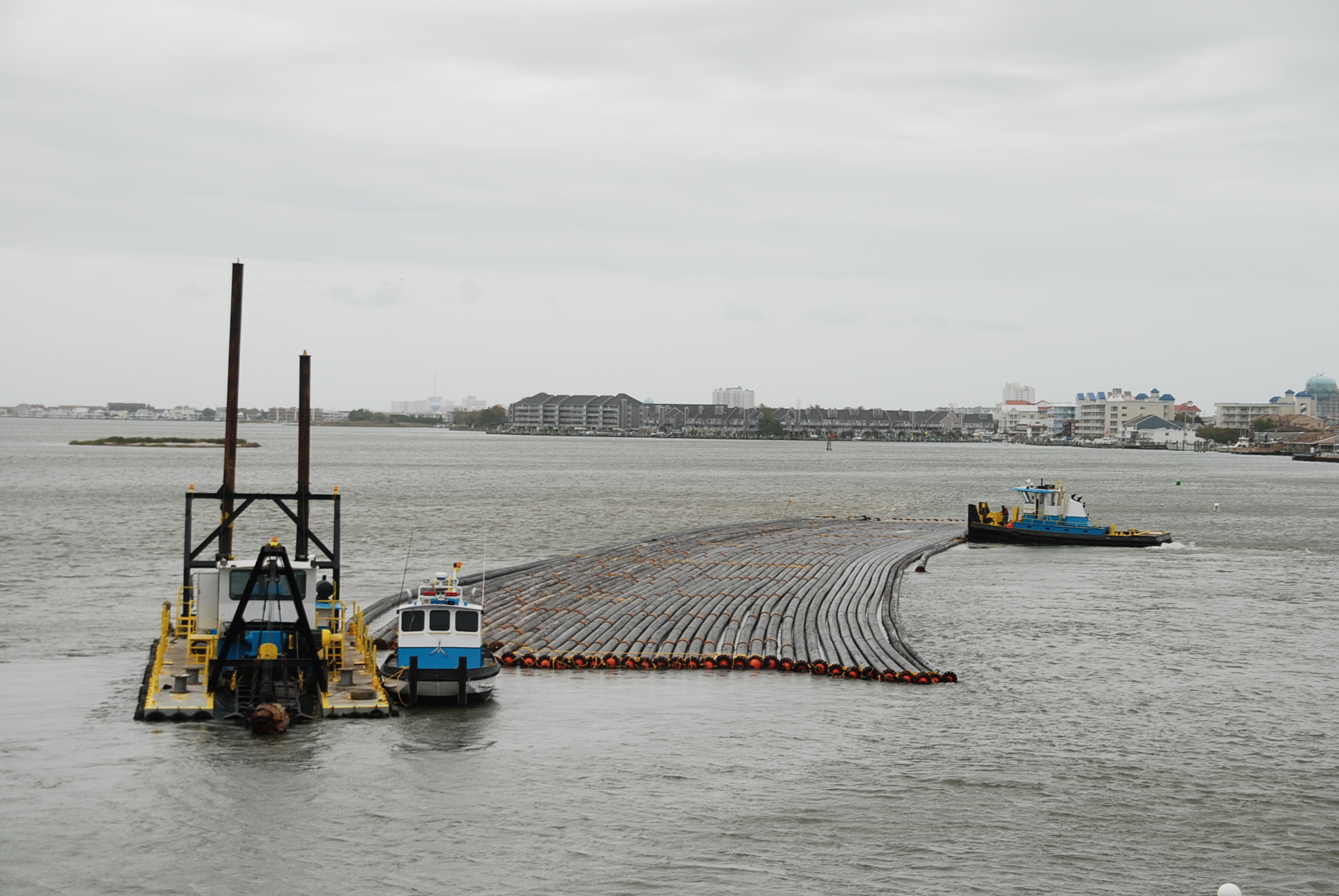 Advance preparations were being made this week in the coastal bays watershed, including placing the large pipes that will carry the dredging material away from the channel. Photo by Shawn Soper