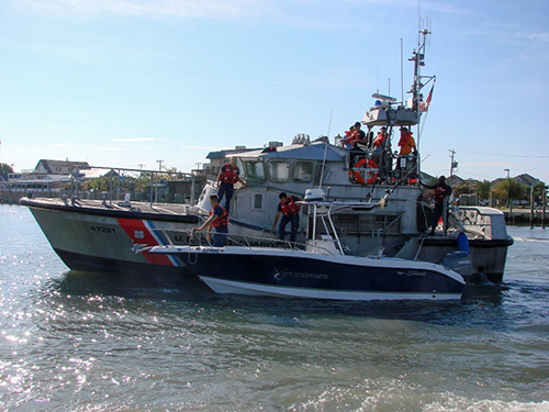Crewmembers aboard a 47-foot Motor Lifeboat from Coast Guard Station Ocean City, Md., pull into the Ocean City marina after a seven-hour evolution, Saturday Sept. 6, 2014.  The crew assisted four boaters after their 25-foot boat became disabled approximately 50 miles east of Ocean City. U.S. Coast Guard photo by Auxiliarist Jerry Wilkins