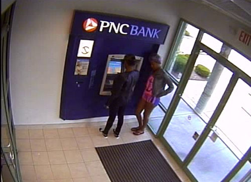 A still image from a surveillance video shows two suspects using a stolen debit card shortly after allegedly swiping it from a nearby gym. Submitted Photo